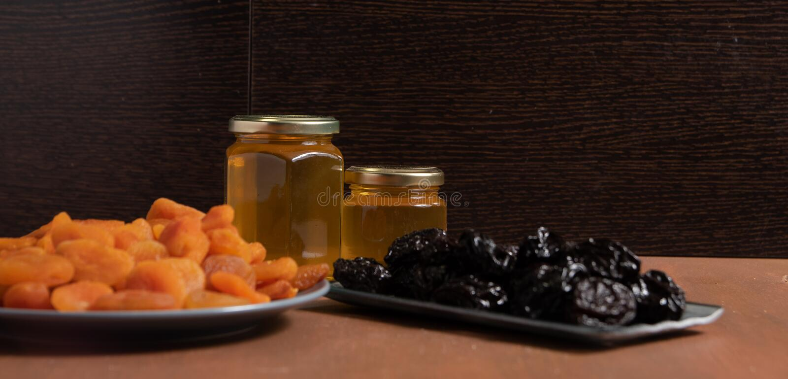 rabbits, honey and plums royalty free stock photo