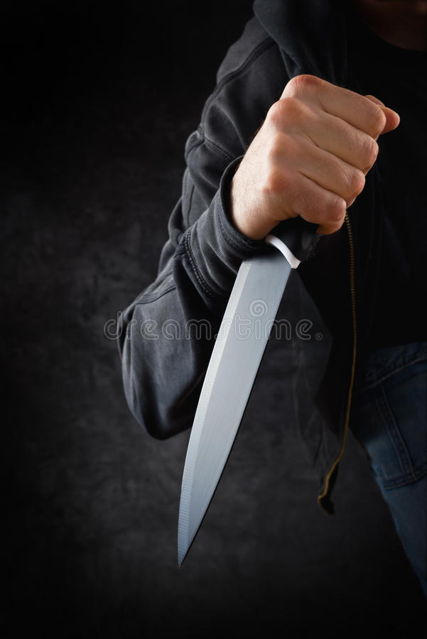 Rabuś z dużym ostrym nożem obrazy stock