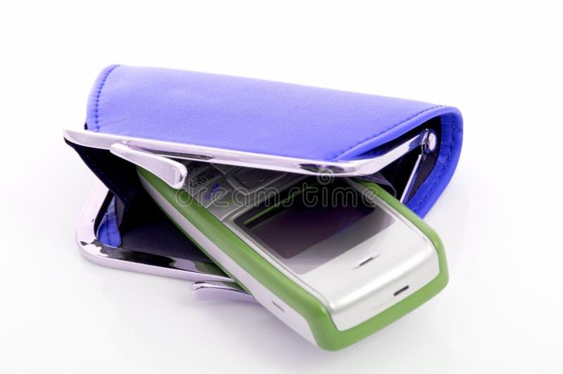 Raccoglitore e cellulare fotografia stock