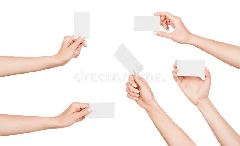 Raccolta della mano femminile con il biglietto da visita fotografia stock