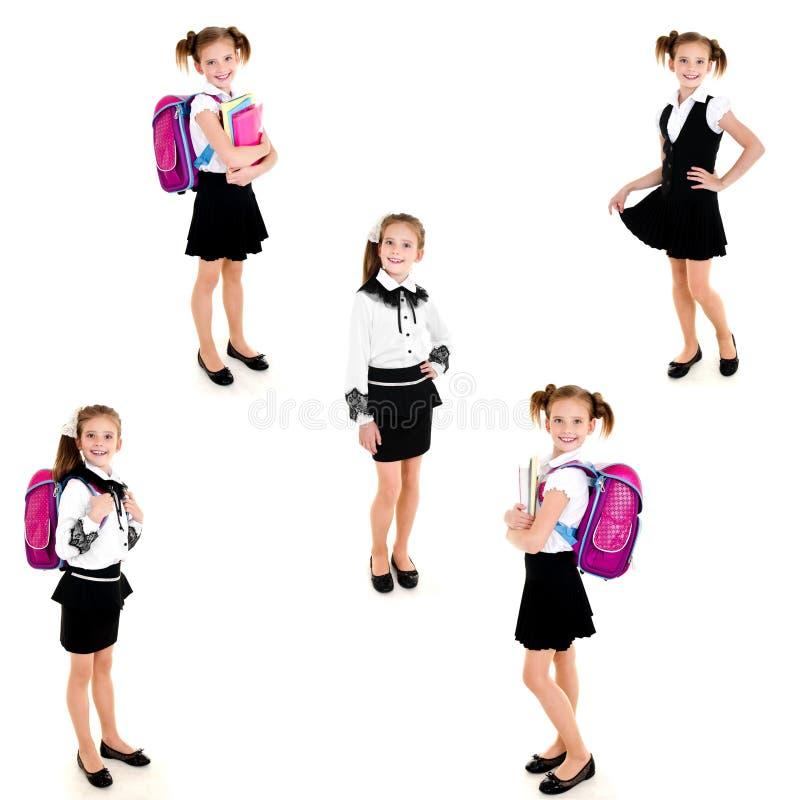 Raccolta della ragazza felice sorridente della scuola delle foto fotografia stock libera da diritti