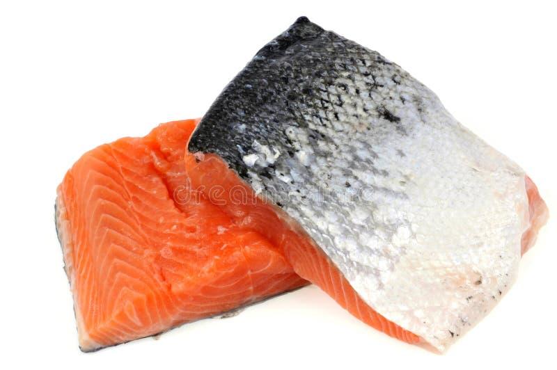 Raccordi di color salmone su un fondo bianco immagini stock