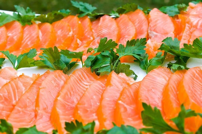 Raccordo dei salmoni affumicati affettato fotografia stock libera da diritti