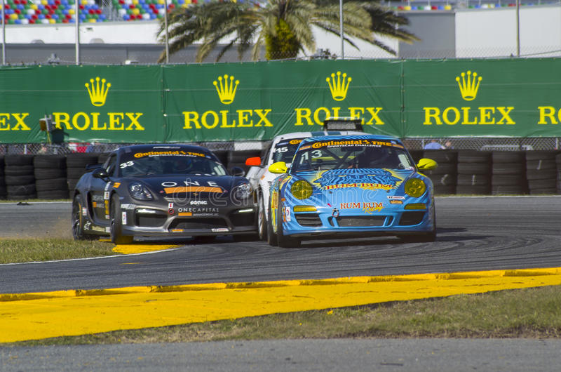 Race action collision of race cars at Daytona Speedway Florida. Two Porsches and a Ford Mustang race car for the lead in the 2016 Continental 200 race at the stock photography