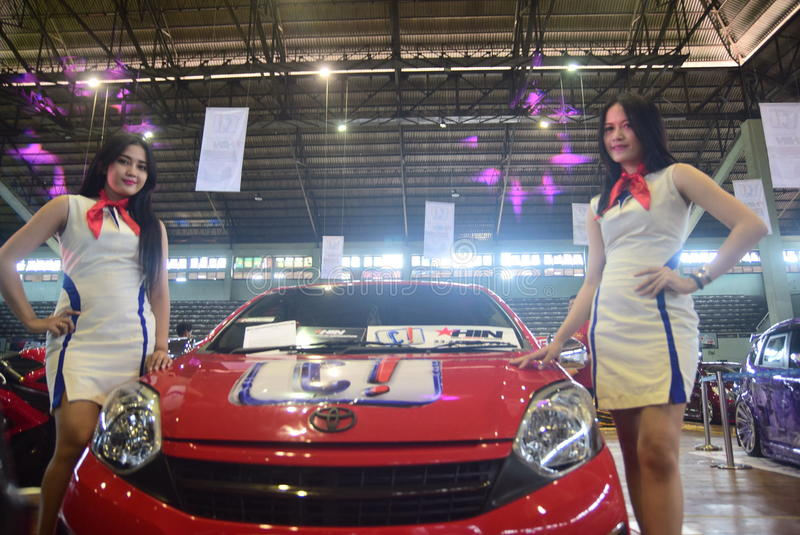 Race car modification. Models pose on cars modifications to race in the GOR Jatidiri Semarang on Saturday, 23 April 2016 Some of the categories involved are stock photos