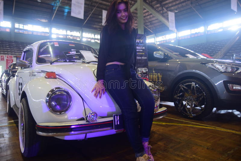 Race car modification. Models pose on cars modifications to race in the GOR Jatidiri Semarang on Saturday, 23 April 2016 Some of the categories involved are royalty free stock photos