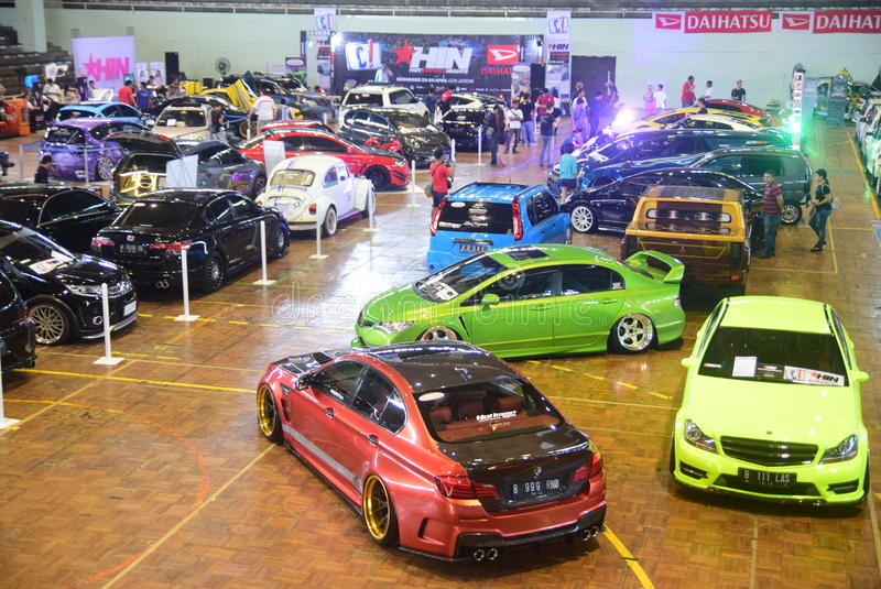 Race car modification. Models pose on cars modifications to race in the GOR Jatidiri Semarang on Saturday, 23 April 2016 Some of the categories involved are stock photography