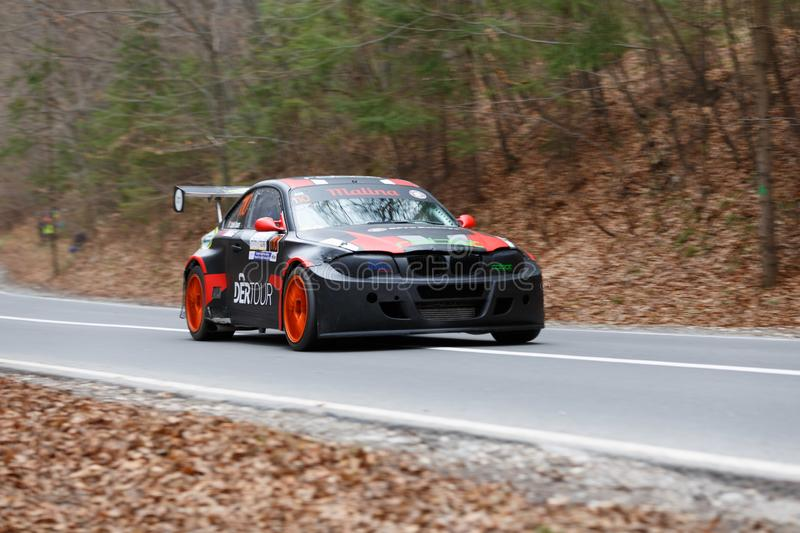 Race car panning shot. From left to right royalty free stock photo