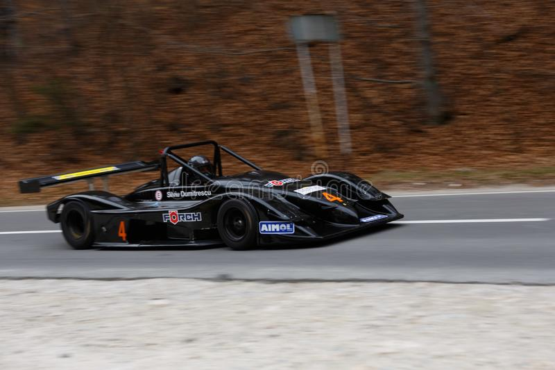 Race car panning shot. From left to right stock photo