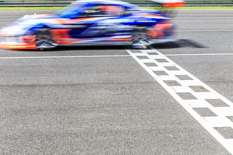 Race car racing. On a track with motion blur stock image