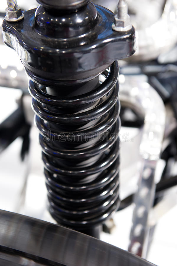 Race car shock absorber. And wheel royalty free stock photos