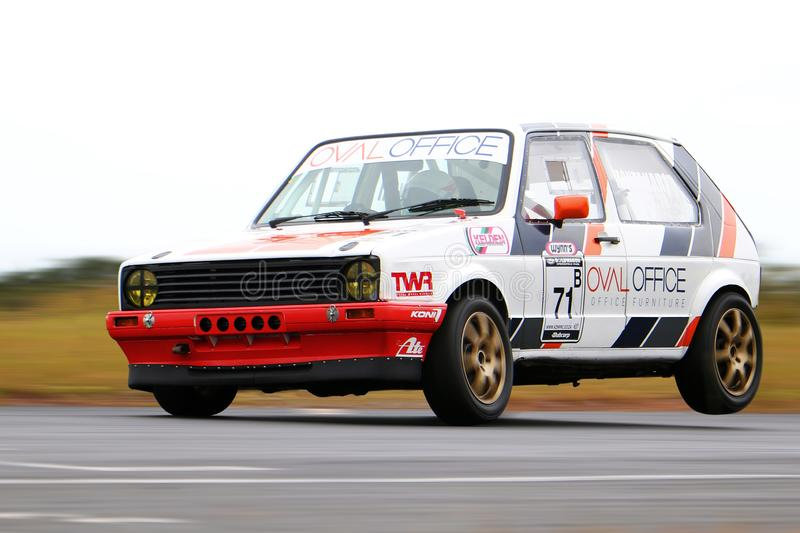 Race car at speed stock photography