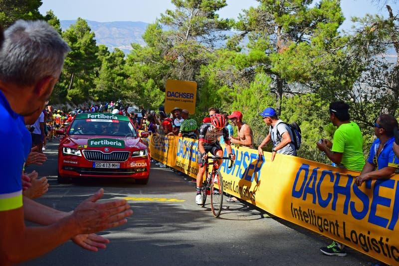 Race Directors Car La Vuelta España Cycle Race. The race director follows a leading rider near the mountain top finish in the 2017 La Vuelta espana bike race royalty free stock photography