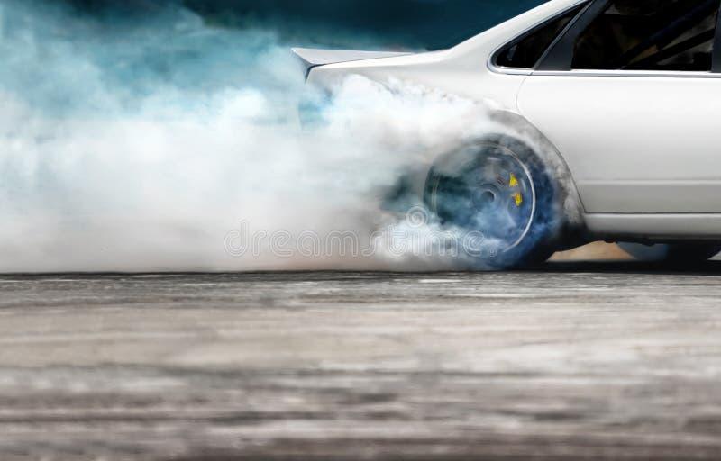 Race drift car burning tires on speed track. Close up Race drift car burning tires on speed track stock photos