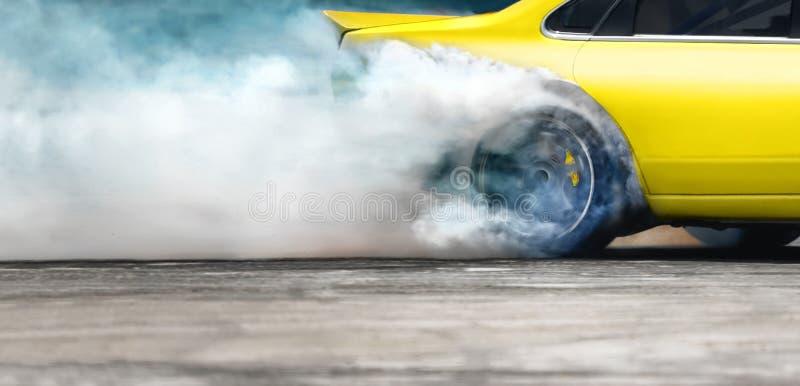 Race drift car burning tires on speed track. Close up Race drift car burning tires on speed track stock image