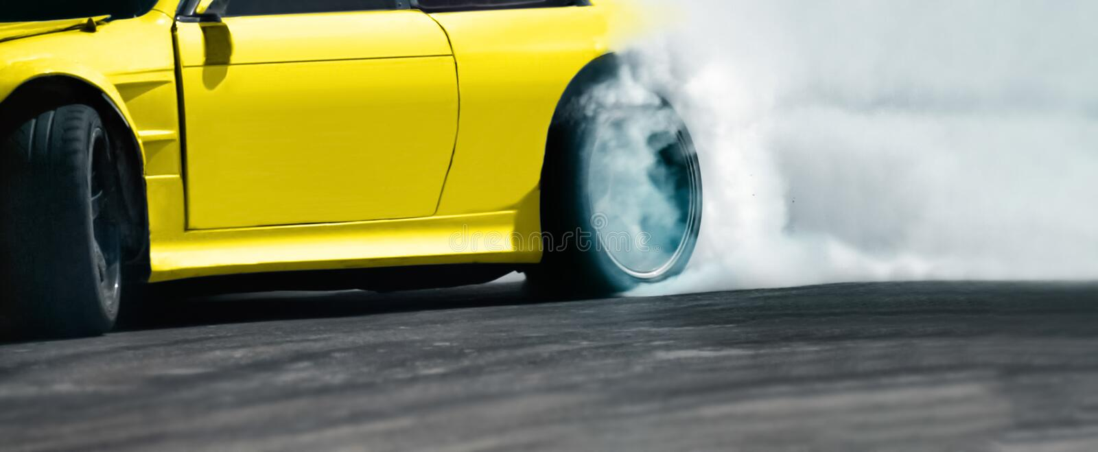 Race drift car burning tires on speed track. Close up Race drift car burning tires on speed track royalty free stock photo