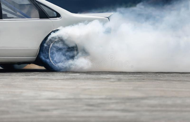 Race drift car burning tires on speed track. Close up Race drift car burning tires on speed track royalty free stock images