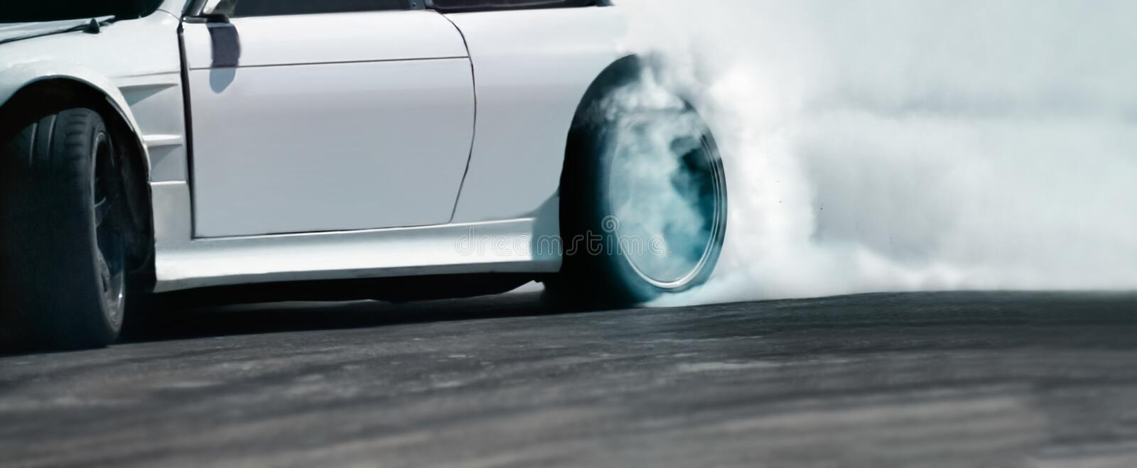 Race drift car burning tires on speed track. Close up Race drift car burning tires on speed track stock images