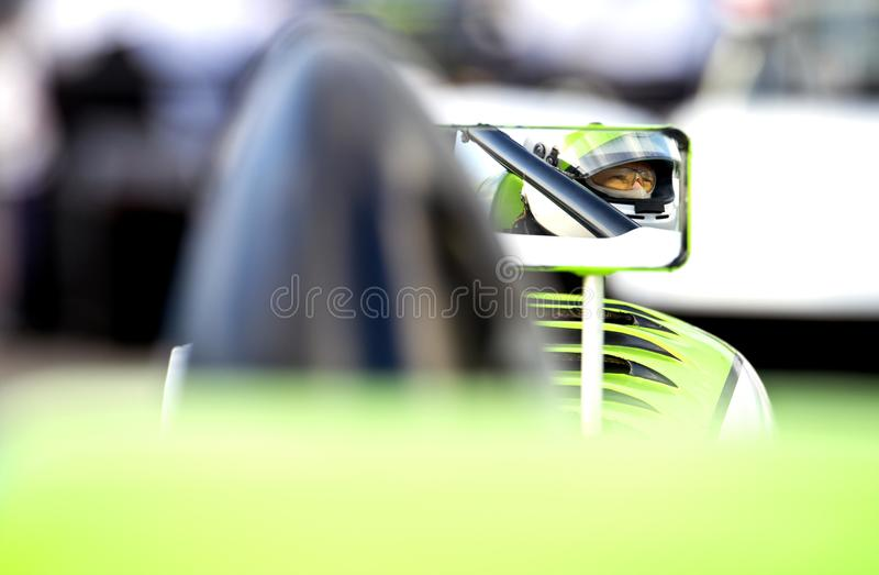 Race driver on starting grid stock photos