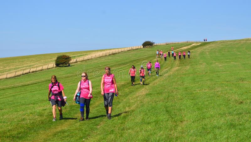 Race For Life Lady walkers on the South Downs stock image