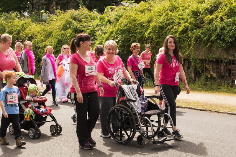 Race for Life sponsored fun run. Liverpool, UK - June 26, 2016: Race for Life sponsored fun run for British charity Cancer Research UK. The race is on, Groups royalty free stock photos