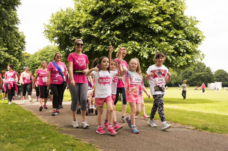 Race for Life sponsored fun run. Liverpool, UK - June 26, 2016: Race for Life sponsored fun run for British charity Cancer Research UK. The race is on, Groups royalty free stock images