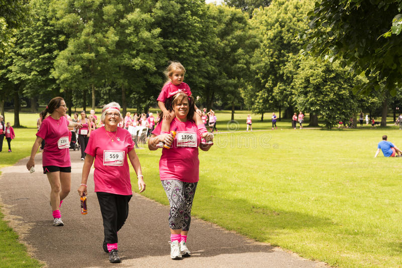 Race for Life sponsored fun run. Liverpool, UK - June 26, 2016: Race for Life sponsored fun run for British charity Cancer Research UK. The race is on, Groups stock photo