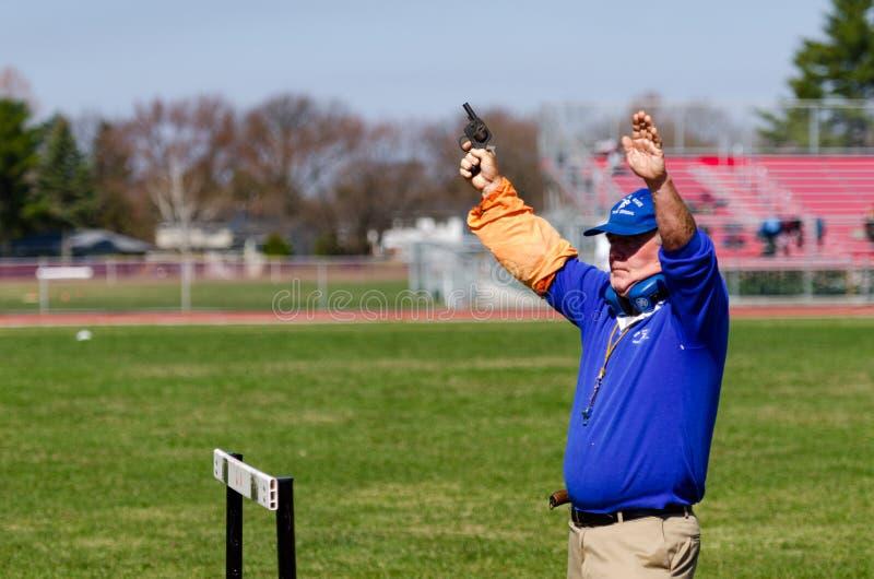 Race Official Shoots Starting Gun stock photos