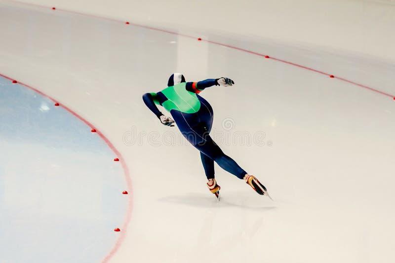 Race sprint speed skating. Female speed skater royalty free stock image