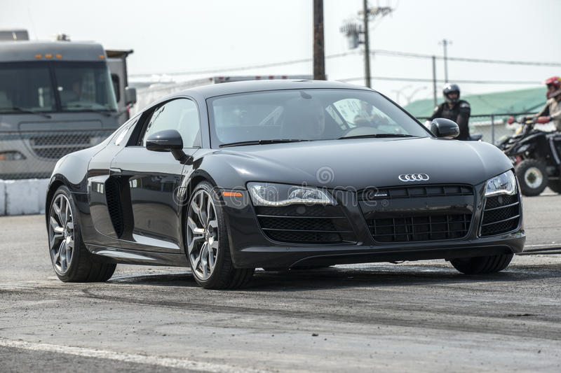 Audi r8. Napierville dragway, July 12, 2015, front side view of audi r8 on the track at the starting line ready to start stock images