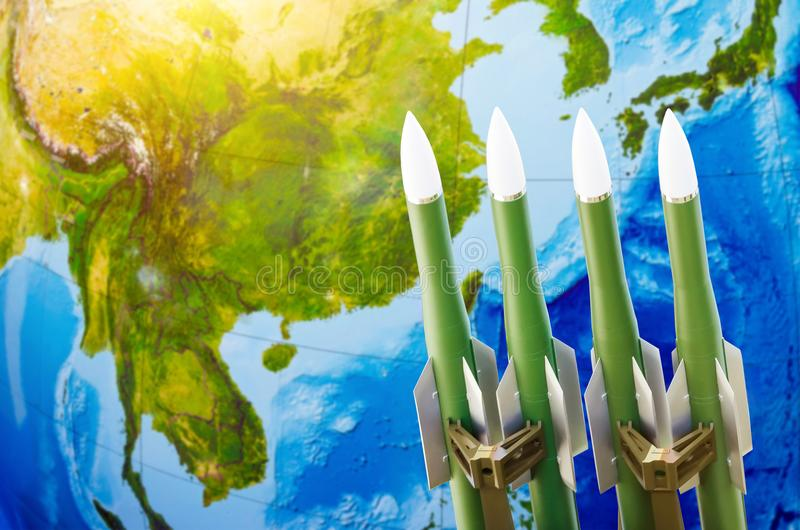 Race of weapons, nuclear weapons, the threat of war in the world. Rockets on the background of Asia- China, Japan, Korea. stock photo