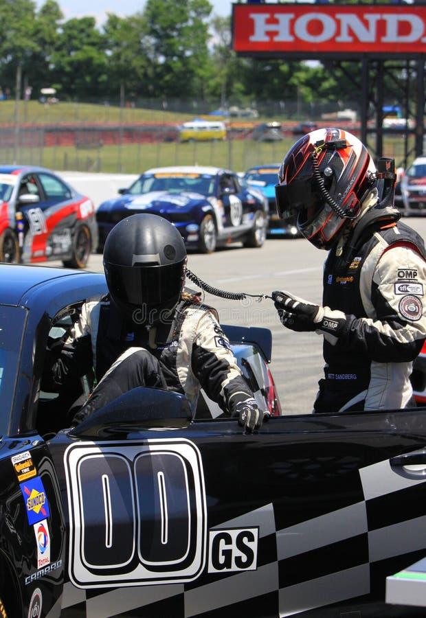 Raceautobestuurders stock afbeeldingen