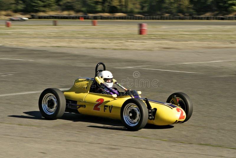 Racecar amarillo de la vendimia fotografía de archivo