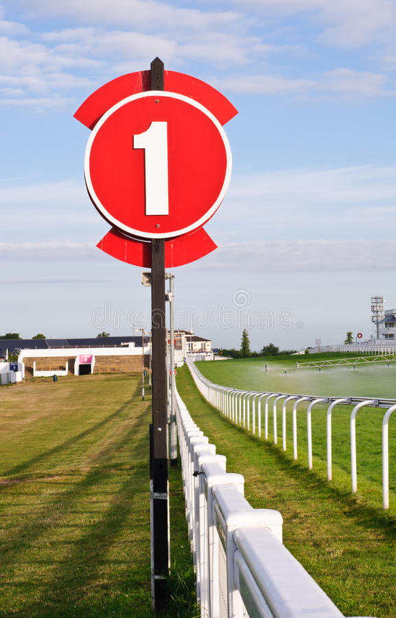 Racecourse in early morning. With furlong sign royalty free stock photography