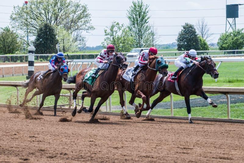 Racecourse - Keeneland Corner 4. Horses making their move around corner 4 stock images