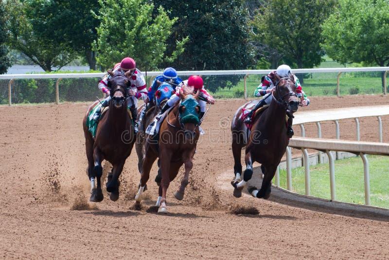 Racecourse - Keeneland. Horses making their move around corner 4 royalty free stock photos