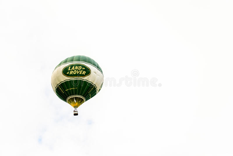Racecourse, Northampton, England, UK - July 01: Hot-air balloon with Land Rover logo flying over Northampton Town stock photography