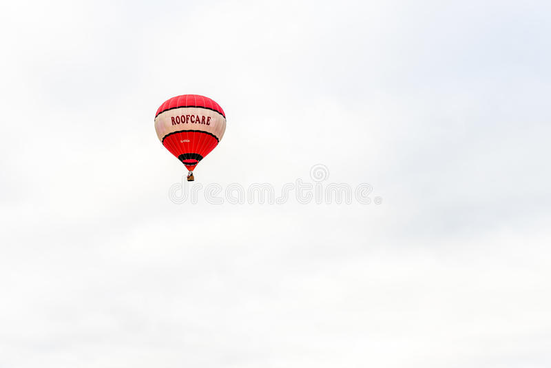 Racecourse, Northampton, England, UK - July 01: Hot-air balloon with Roofcare logo flying over Northampton Town Festival stock photography