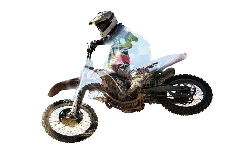 Racer on motorcycle participates in motocross cross-country in flight, jumps and takes off on springboard against sky royalty free stock images