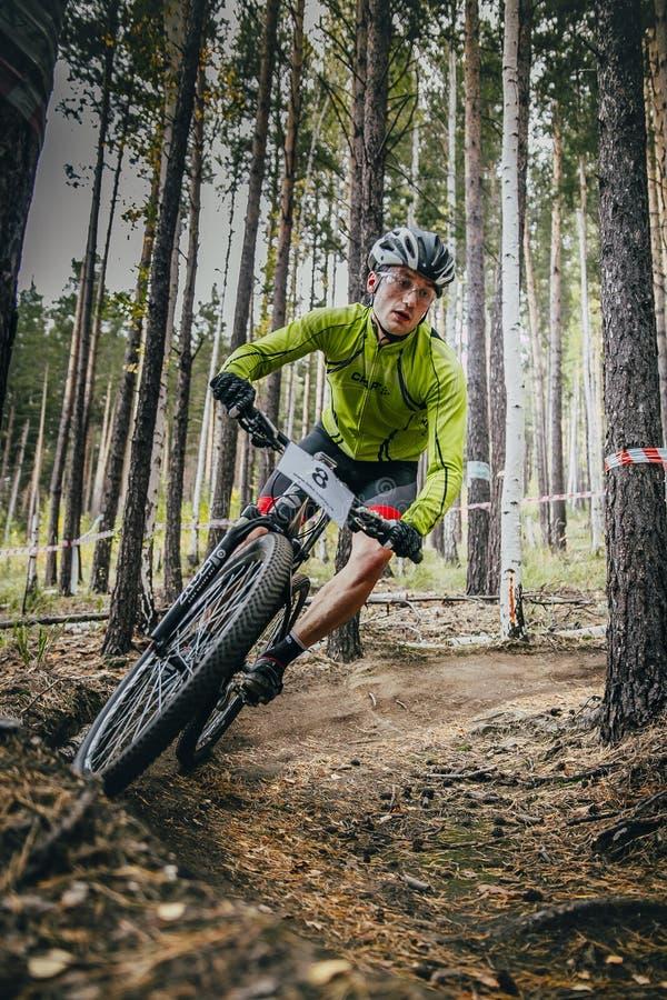 Racer on mountain bike rides on a u-turn royalty free stock image