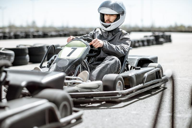Man driving kart on the track royalty free stock photography