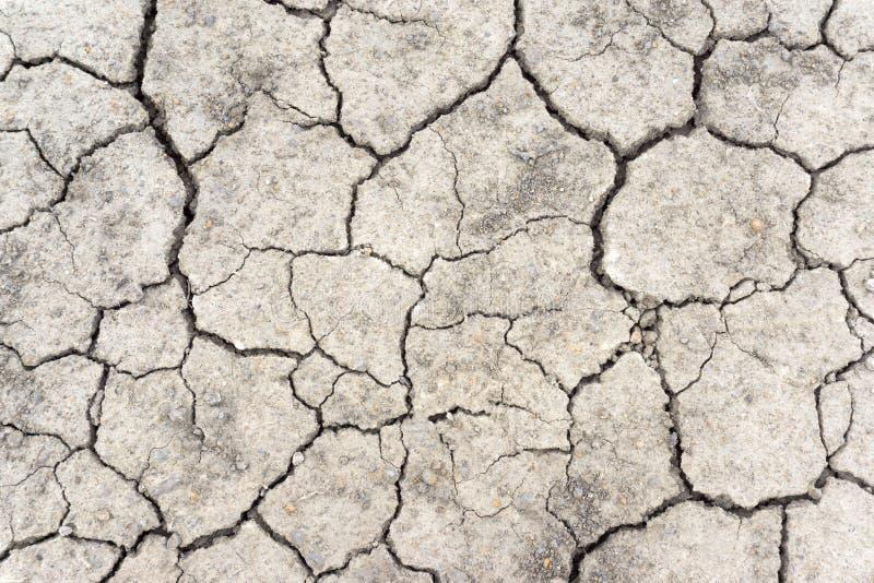 Rache o solo na estação seca, aquecimento global/rachou a lama secada/secam o fundo rachado da terra/terra rachada, terra no drou fotos de stock royalty free