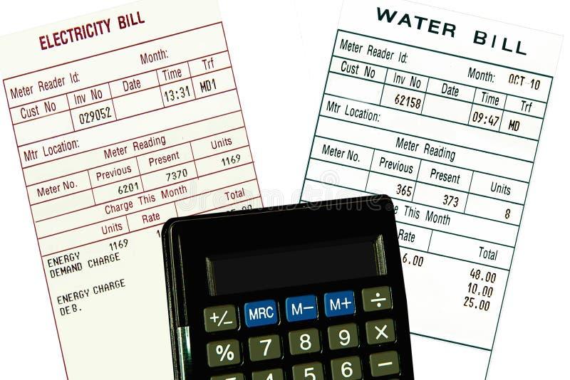 rachunków kalkulatora pojęcia elektryczności woda obraz stock