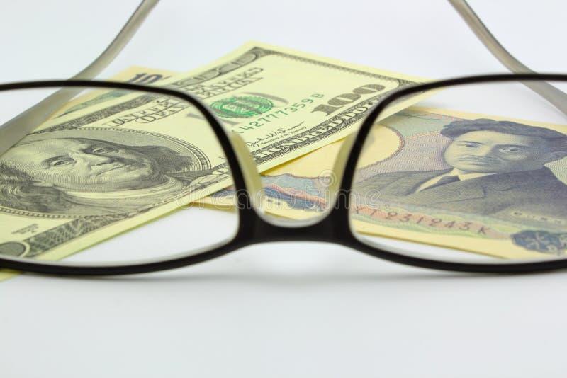 rachunku dolarowy eyeglass jen fotografia royalty free