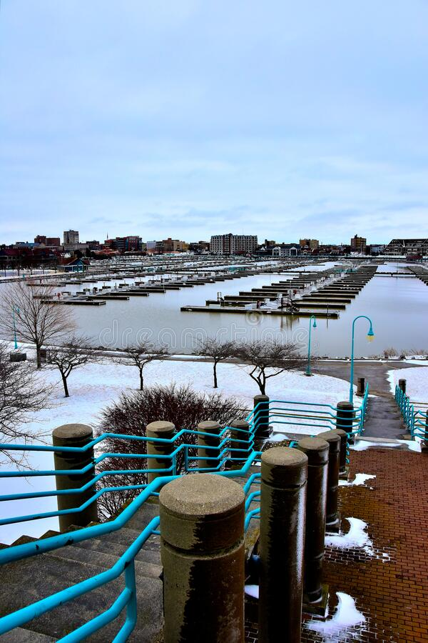 Racine Wisconsin Harbor in Winter with Cloudy Skies. Looking down from the viewing platform toward the harbor at Racine Wisconsin in winter with open waters and stock image