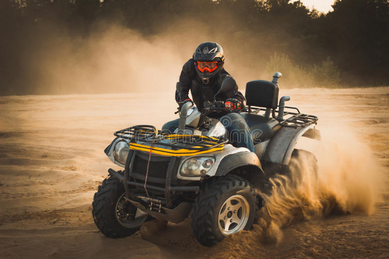 Racing ATV is sand. stock photography