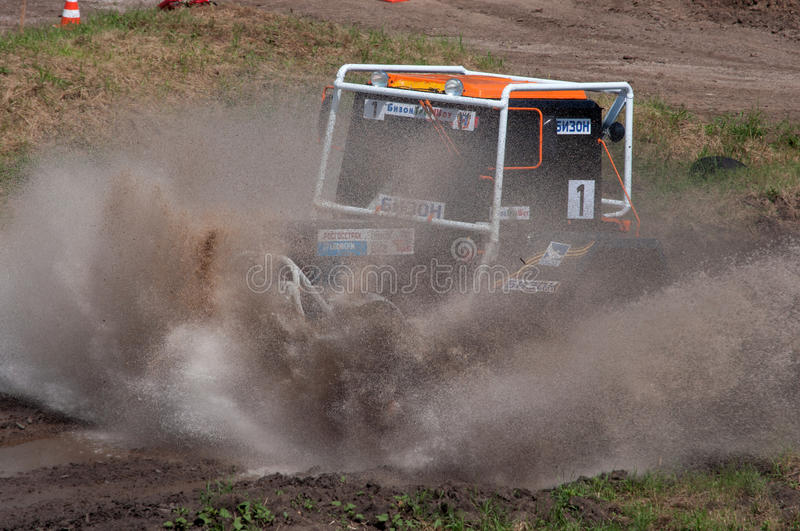 Racing on Belarus tractors. Races on rough terrain, take place annually at the former testing ground `Don-25`, Rostov-on-Don, Russia, At different times, cars royalty free stock images