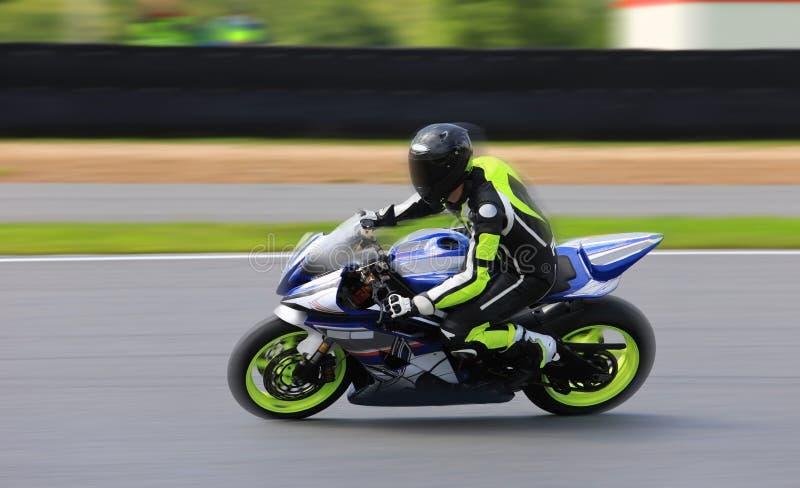 Racing bike rider racing at high speed stock photos