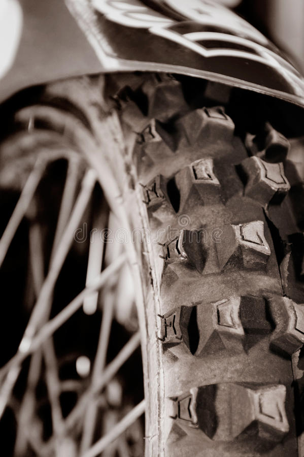 Racing Bike Tire. Artistic close-up of a racing bike tire tread Sepia toned royalty free stock photos