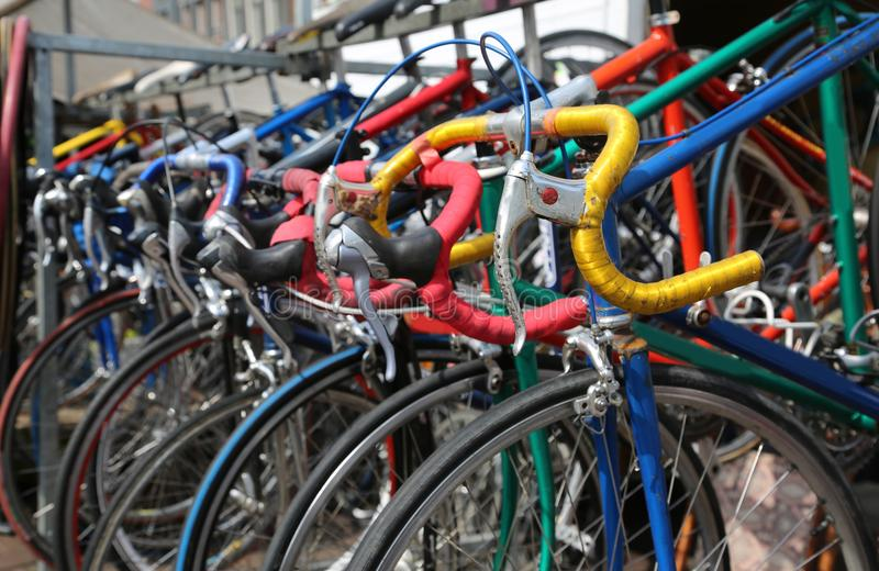 Racing bikes for sale on the market of used things in Europe. Many racing bikes for sale on the market of used things in Europe royalty free stock photography